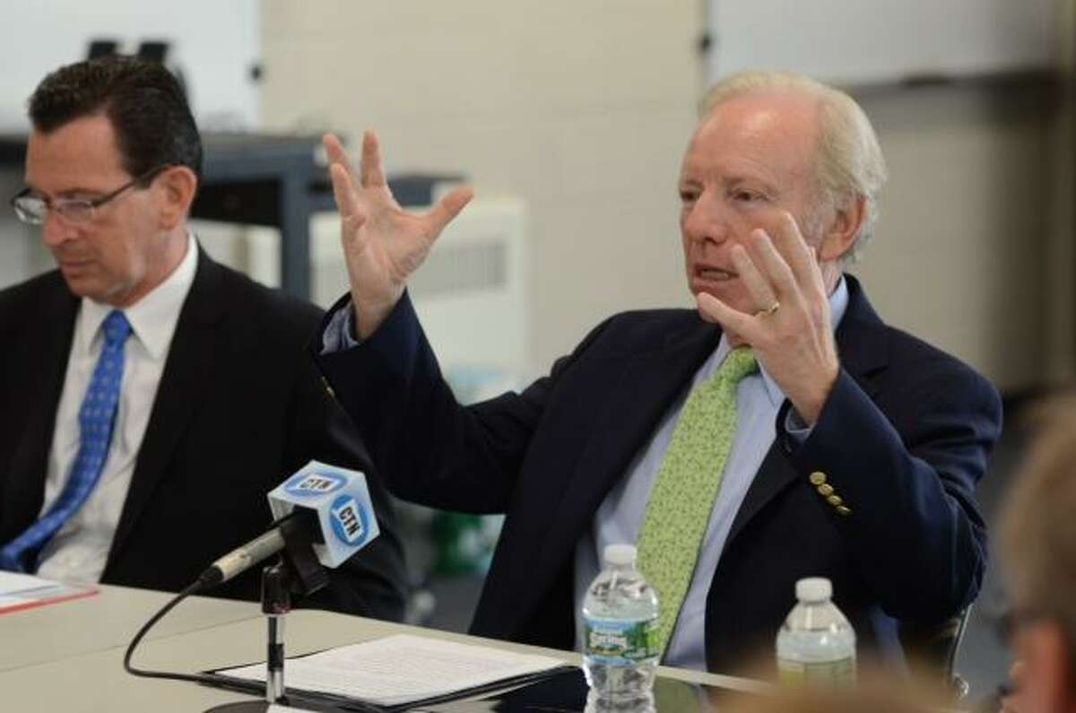 Sen. Lieberman, right, leading the discussion, with Gov. Dannel P. Malloy sitting at left. V.M. Williams/Register