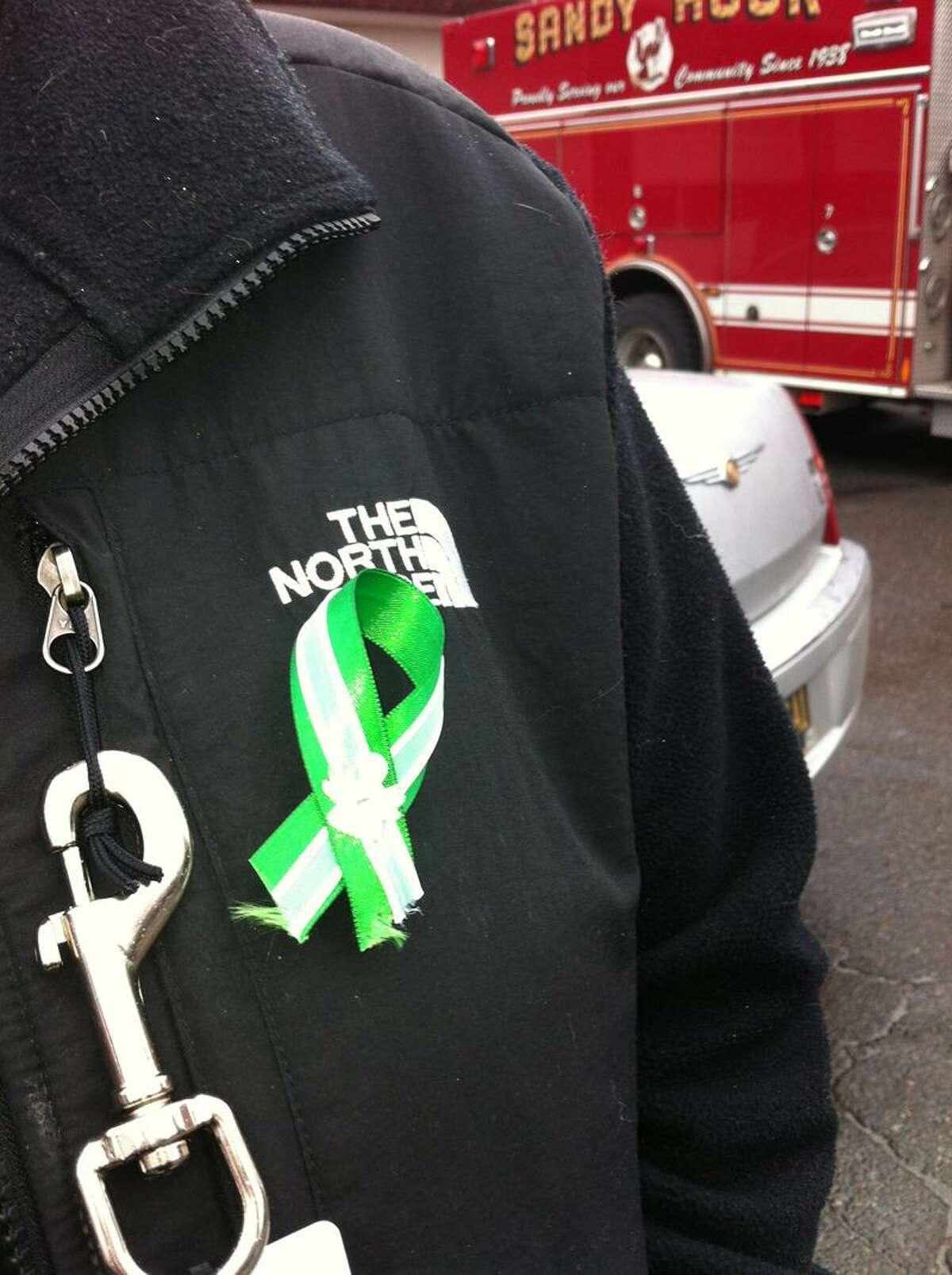 Sandy Hook firefighter Kelly Burton's green and white ribbon. Photo by Mark Zaretsky/New Haven Register