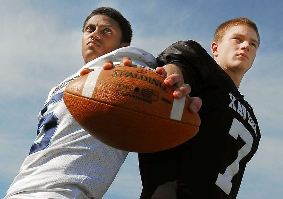 Catherine Avalone/The Middletown PressMiddletown sophomore quarterback, Dario Highsmith and Xavier senior quarterback Tim Boyle.