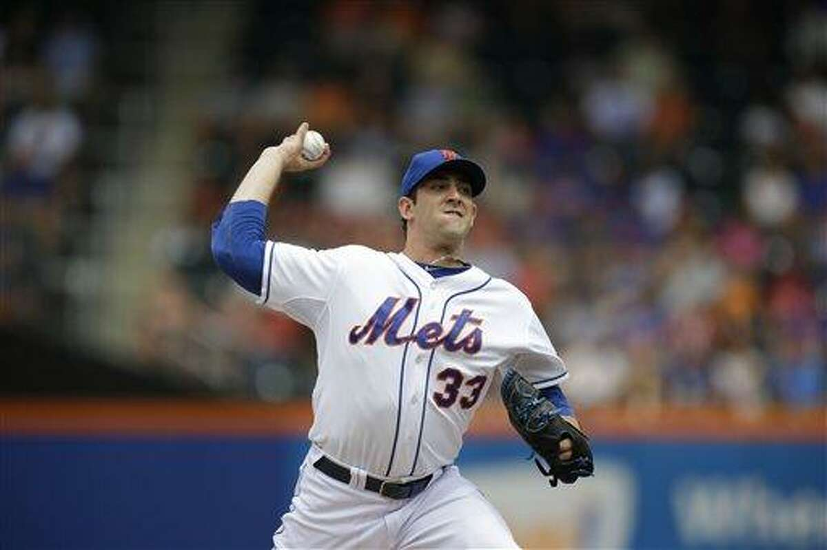 New York Mets starting pitcher Matt Harvey delivers in the first inning of a baseball game Sunday, July 21, 2013, in New York. (AP Photo/Kathy Willens)