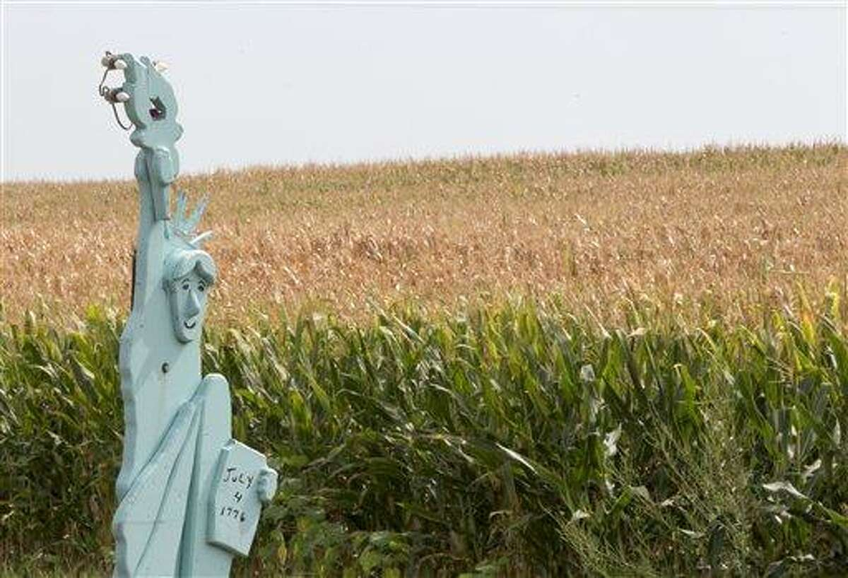 A rendition of Lady Liberty stands in front of a parched corn field Aug. 1 near Crete, Neb. The front row of corn remains green because it is irrigated by a lawn sprinkler. The latest U.S. drought map shows that excessively dry conditions continue to worsen in the Midwest states that are key producers of corn and soybeans. This is the worst U.S. drought in decades. The weekly U.S. Drought Monitor map released Thursday shows that the area gripped by extreme or exceptional drought rose nearly 2 percent to 24.14 percent. Associated Press