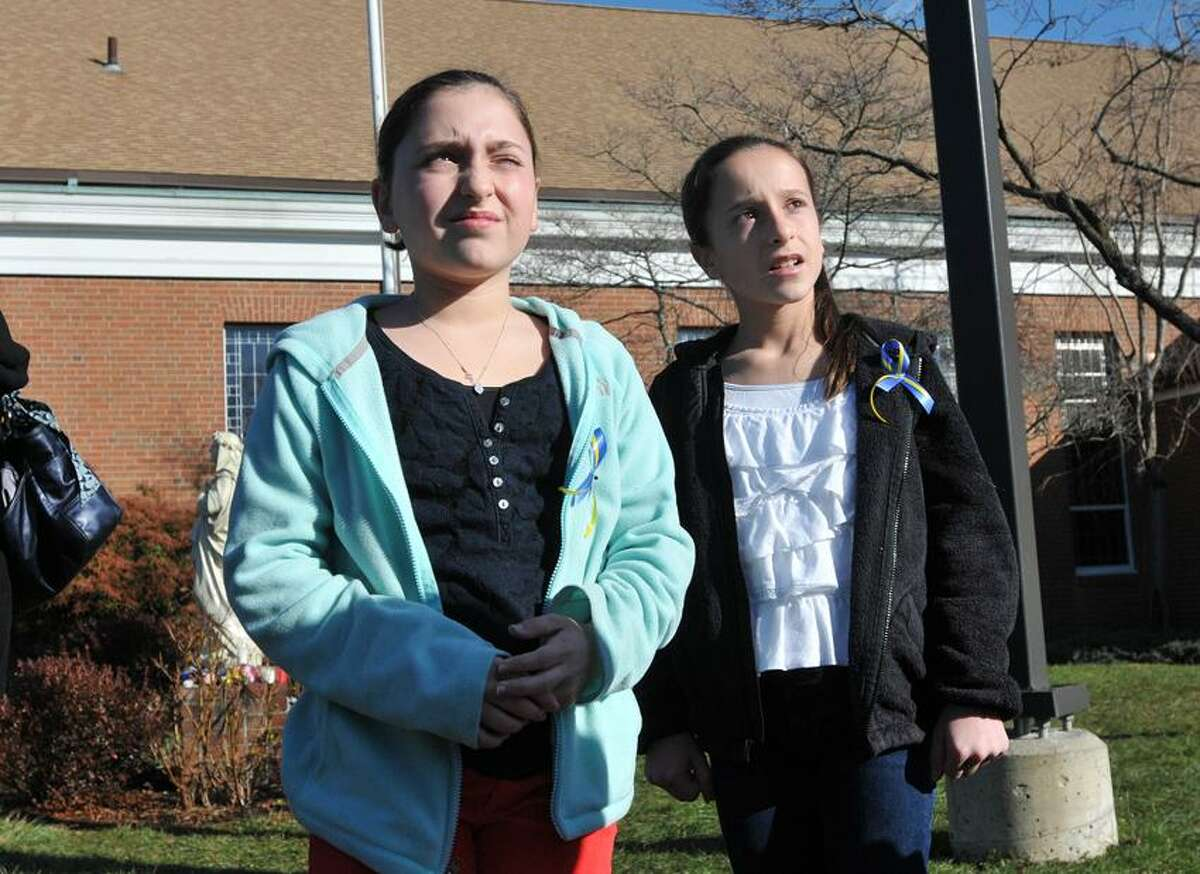 Twins, Tess, left, and Olivia Mubarek, 12, attended Sandy Hook Elementary School through 4th grade. They were at the St. Rose of Lima church, where they released 26 balloons to remember the victims. Peter Casolino/Register