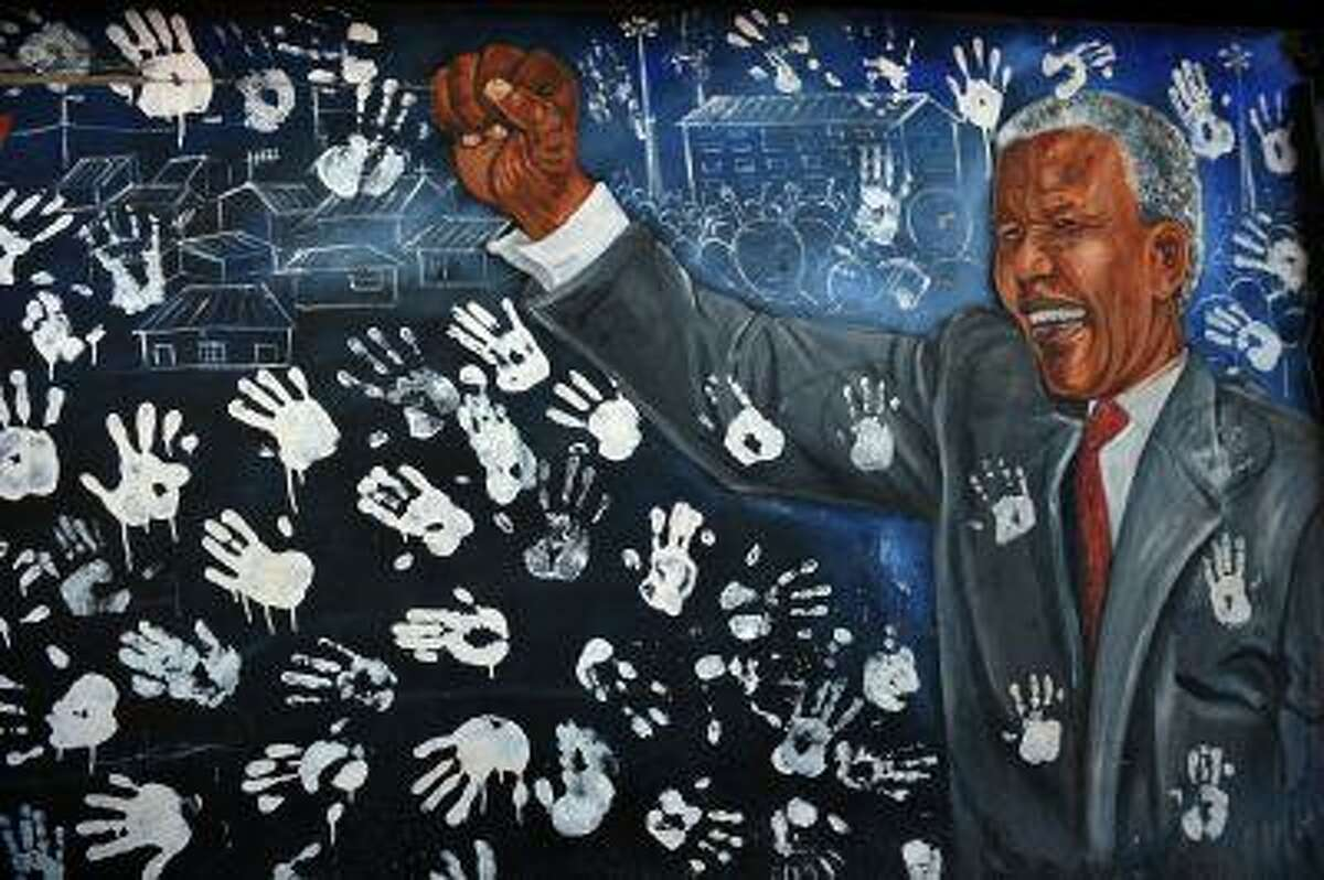 A mural showing former South African President Nelson Mandela is pictured near his former house in Alexandra township on June 28, 2013.