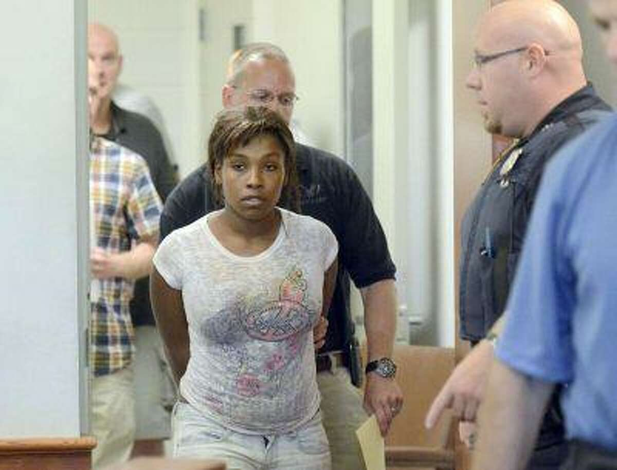 Audrea Gause 26, of Troy, N.Y., is lead into Troy, N.Y., Police Court Friday July 19, 2013 being arraigned on a Massachusetts fugitive warrant in Troy, N.Y.