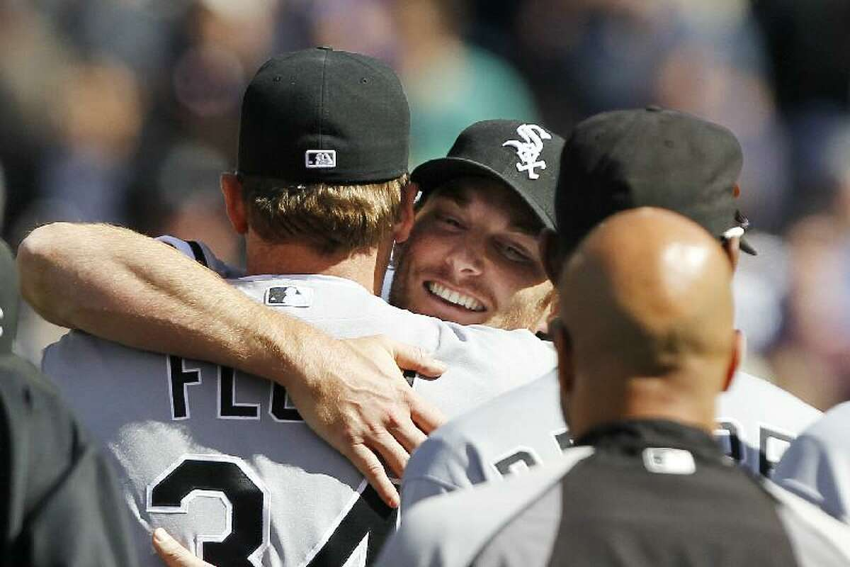 ASSOCIATED PRESS Chicago White Sox starting pitcher Philip Humber, center, is mobbed by teammates after pitching a perfect game against the Seattle Mariners on Saturday at Safeco Field in Seattle. The White Sox won 4-0.
