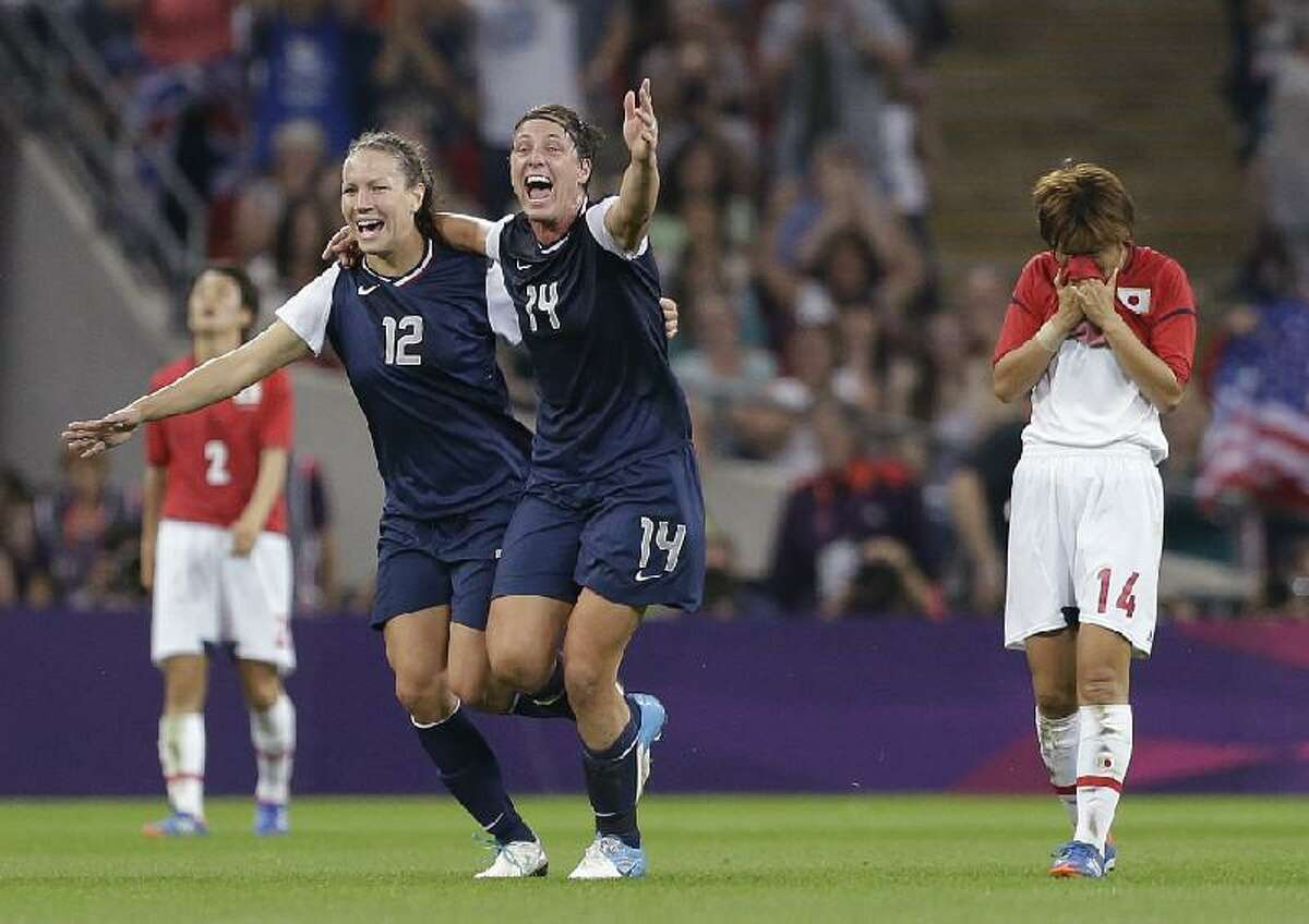 ASSOCIATED PRESS United States' Lauren Cheney (12) and Abby Wambach (14) celebrate as Japan's Asuna Tanaka (14) and Yukari Kinga (2) react after the United States won the women's soccer gold medal match at the 2012 Summer Olympics Thursday in London.