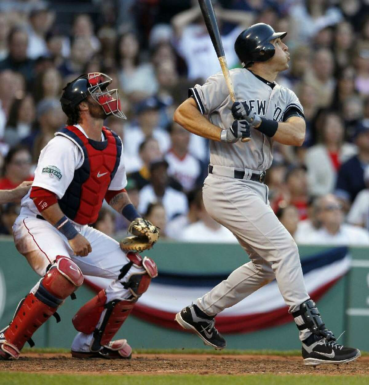 ASSOCIATED PRESS New York Yankees first baseman Mark Teixeira, right, watches his three-run home run in front of Boston Red Sox catcher Jarrod Saltalamacchia in the seventh inning of Saturday's game at Fenway Park in Boston. The Yankees rallied from a 9-0 deficit to win 15-9.