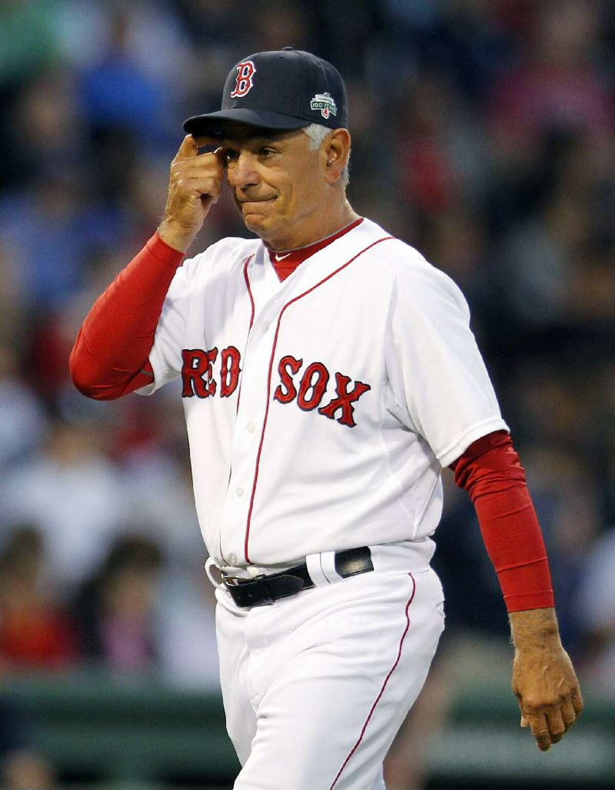ASSOCIATED PRESS Boston Red Sox manager Bobby Valentine walks back to the dugout after removing pitcher Alfredo Aceves in the eighth inning of Saturday's game against the New York Yankees at Fenway Park in Boston. The Yankees rallied from a 9-0 deficit to win 15-9.