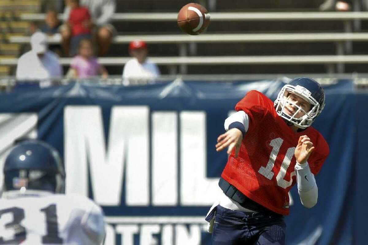 ASSOCIATED PRESS/THE DAY, TIM COOK Connecticut quarterback Chandler Whitmer throws a pass during the second quarter of the annual Blue-White scrimmage on Saturday afternoon at Rentschler Field in East Hartford.