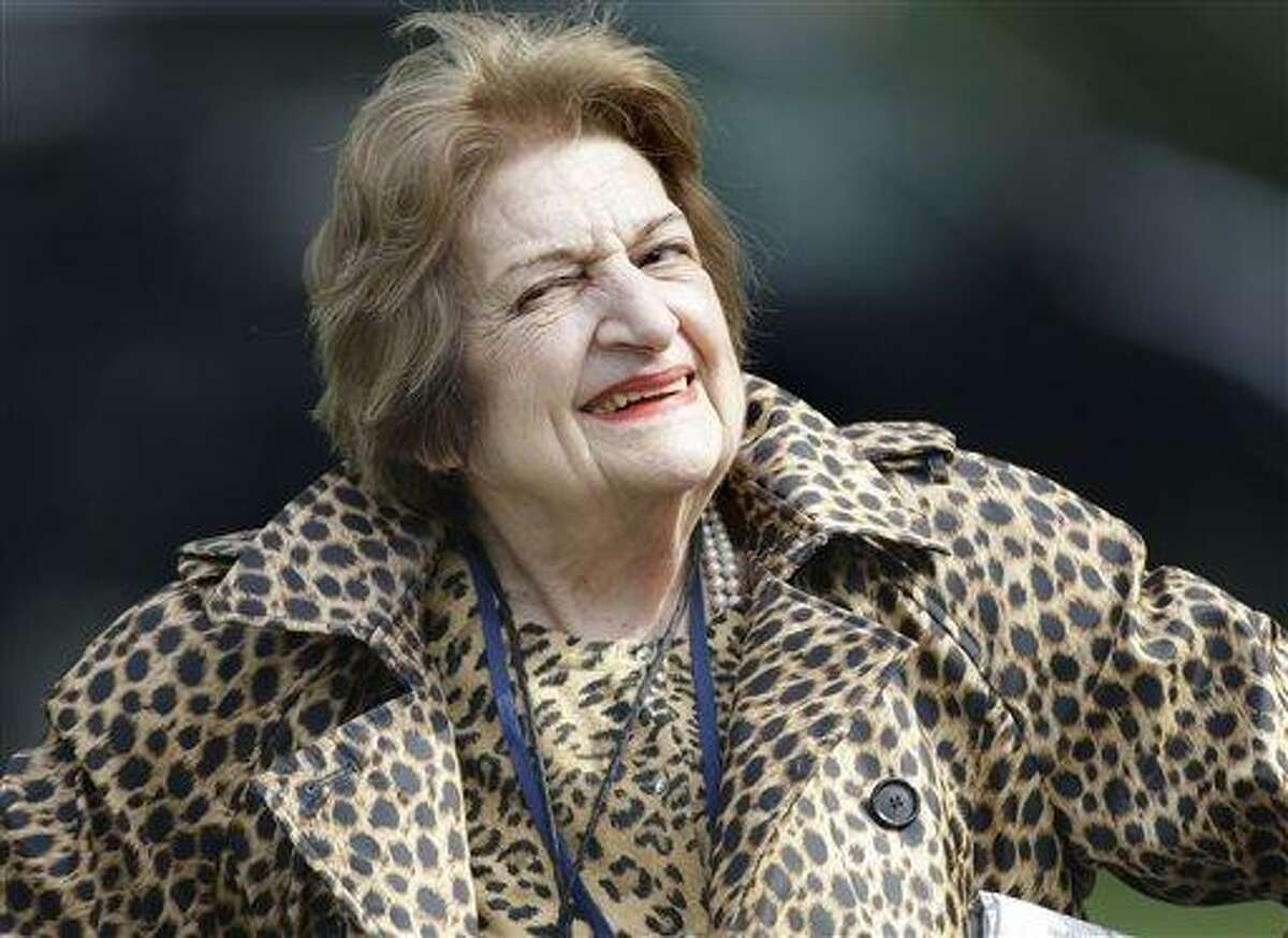 """In this photo taken Oct. 16, 2007, veteran White House correspondent Helen Thomas smiles as she leaves the White House after attending a briefing. Thomas, a pioneer for women in journalism and an irrepressible White House correspondent, has died. She was 92. A friend said Thomas died at her apartment in Washington on Saturday morning. Thomas made her name as a bulldog for United Press International in the great wire-service rivalries of old. She used her seat in the front row of history to grill nine presidents _ often to their discomfort and was not shy about sharing her opinions. She was persistent to the point of badgering; one White House press secretary described her questioning as """"torture"""" _ and he was one of her fans. (AP Photo/Ron Edmonds)"""
