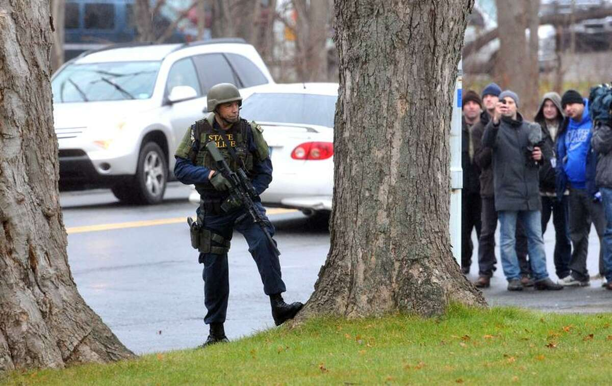 Newtown--Tense moments at St. Rose's of Lima Church in Newtown during noon mass after CT State Police Swat teams and police evacuated the church and surrounded and searched the rectory. Early indications from bystanders were that their was a bomb threat. Photo-Peter Casolino 12/16/12