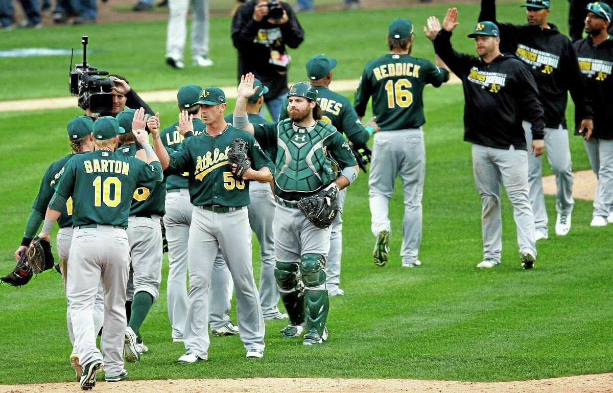 The Athletics celebrate their 6-3 win over the Detroit Tigers in Game 3 on Monday.