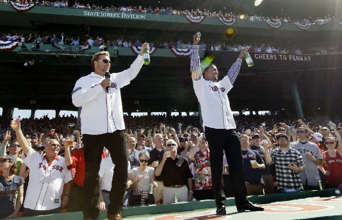 ASSOCIATED PRESS While a little awkward, not even the 'boozy' toast by former self-proclaimed idiots Kevin Millar, left, and Pedro Martinez could put a damper on what was a stirring ceremony celebrating the 100th anniversary of Fenway Park Friday, according to Register columnist Chip Malafronte.