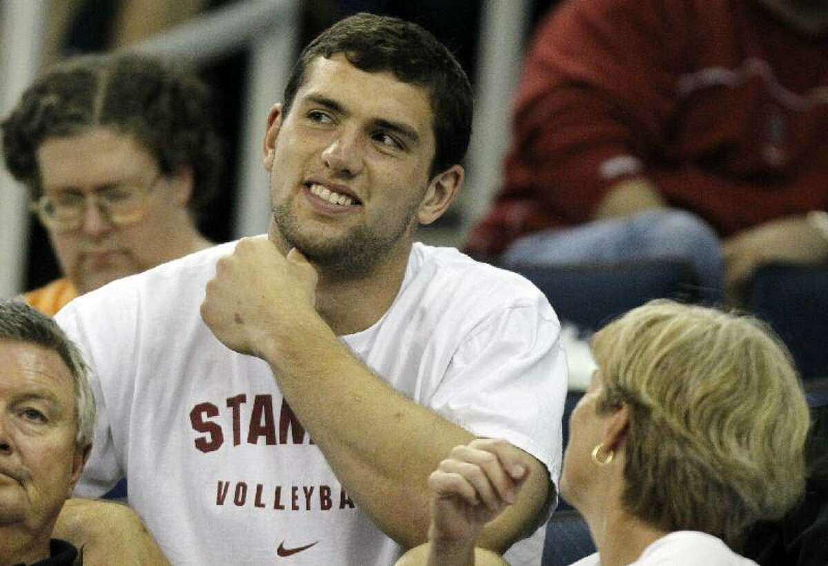 ASSOCIATED PRESS Former Stanford quarterback Andrew Luck sits in the stands before finals of the NCAA women's gymnastics championships on Saturday in Duluth, Ga. Luck will likely be the No. 1 pick when the NFL Draft begins on Thursday.