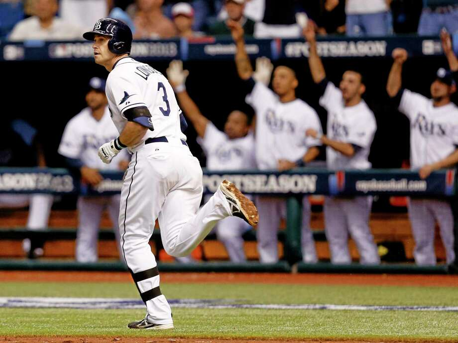 The Rays' Evan Longoria watches his three-run home run in the fifth inning of Game 3 of the ALDS on Monday. Photo: Mike Carlson — The Associated Press  / FR155492 AP