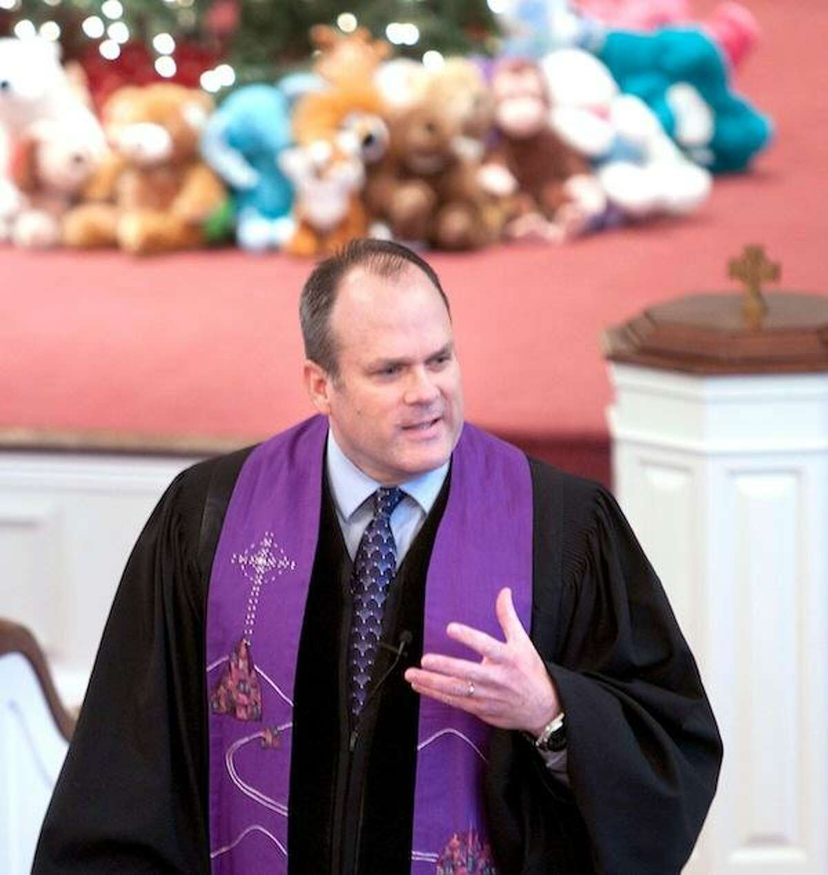 Rev. Matthew Crebbin, senior pastor, speaks to the congregation during worship service at the Newtown Congregational Church on Sunday morning 12/16/2012.Photo by Arnold Gold/New Haven Register