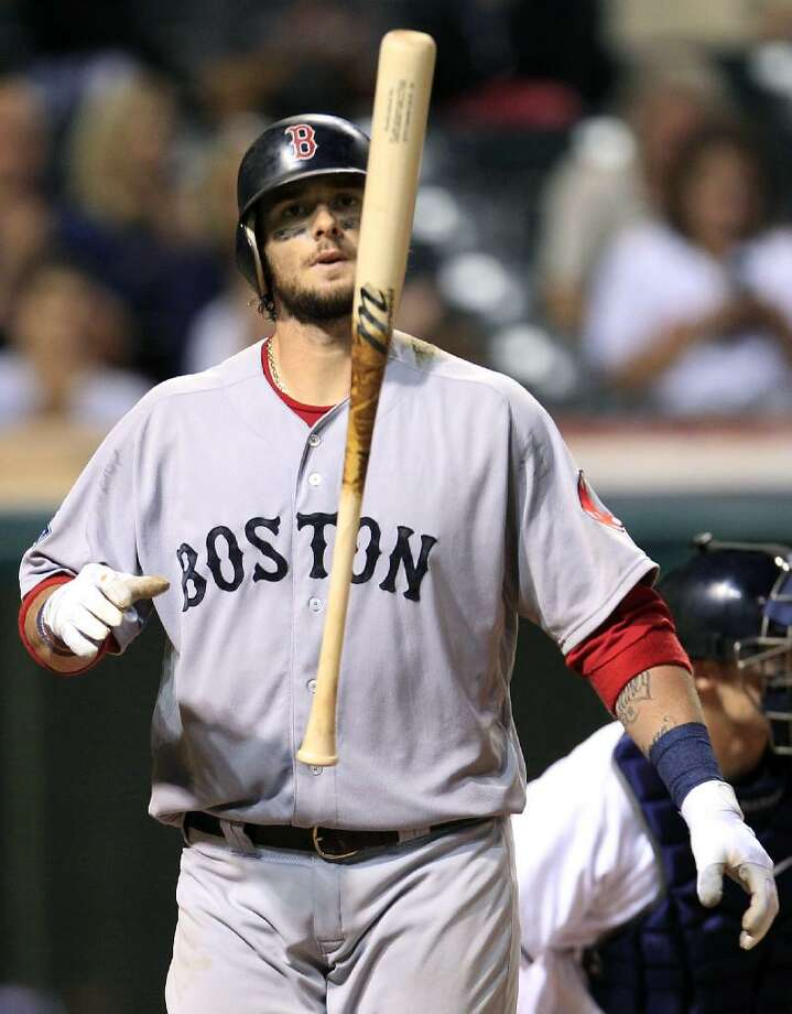 ASSOCIATED PRESS Boston Red Sox's Jarrod Saltalamacchia tosses his bat after striking out against Cleveland Indians relief pitcher Vinnie Pestano in the eighth inning of Thursday night's game in Cleveland. The Red Sox lost 5-3, their seventh loss in the last nine games.