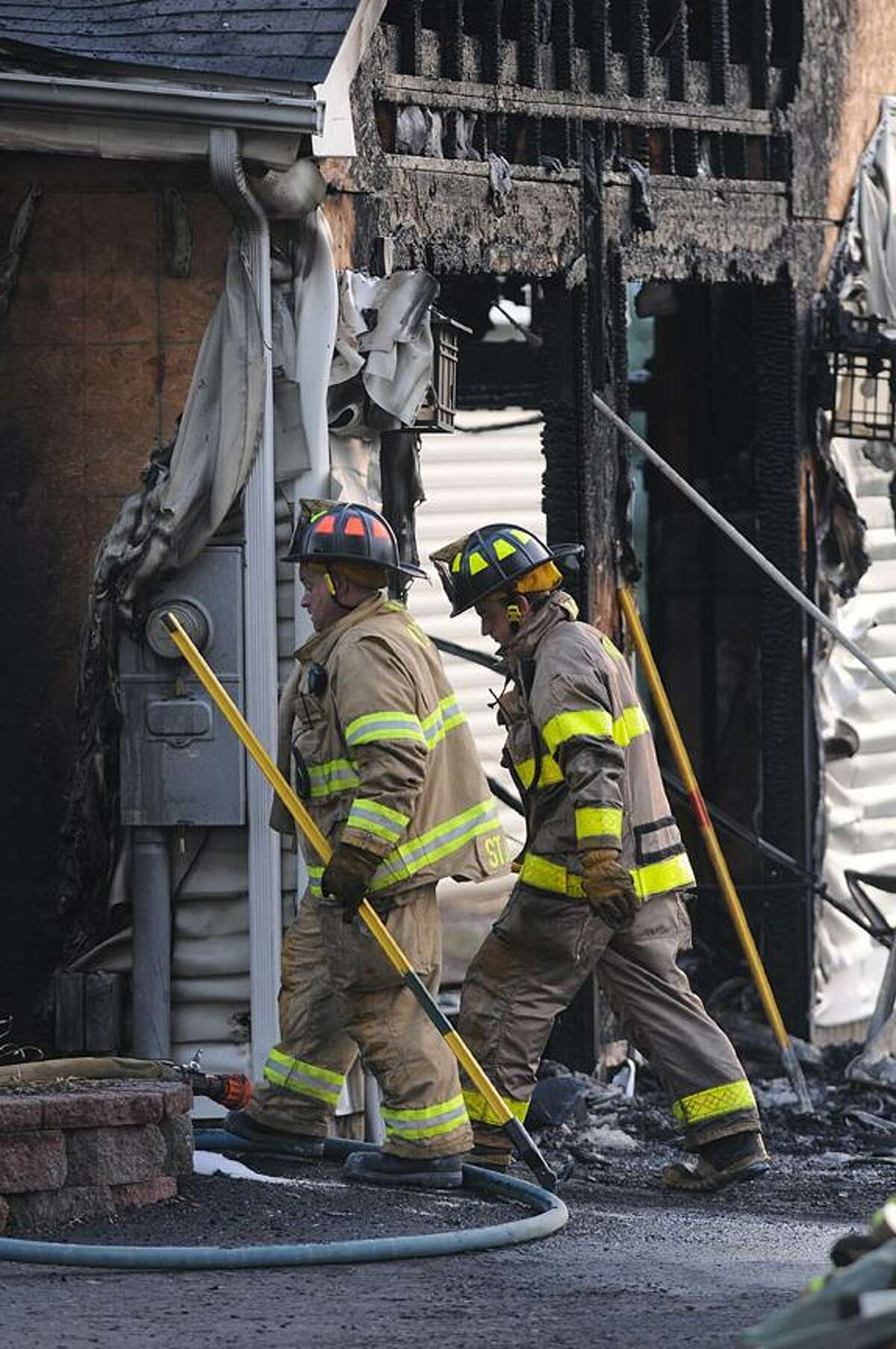 Catherine Avalone - The Middletown Press Firefighters responded around 5:45 p.m. Saturday afternoon to a newer colonial home at 329 Cherry Hill Road in Middlefield. Police said the fire started as a result of a car parked in the garage.