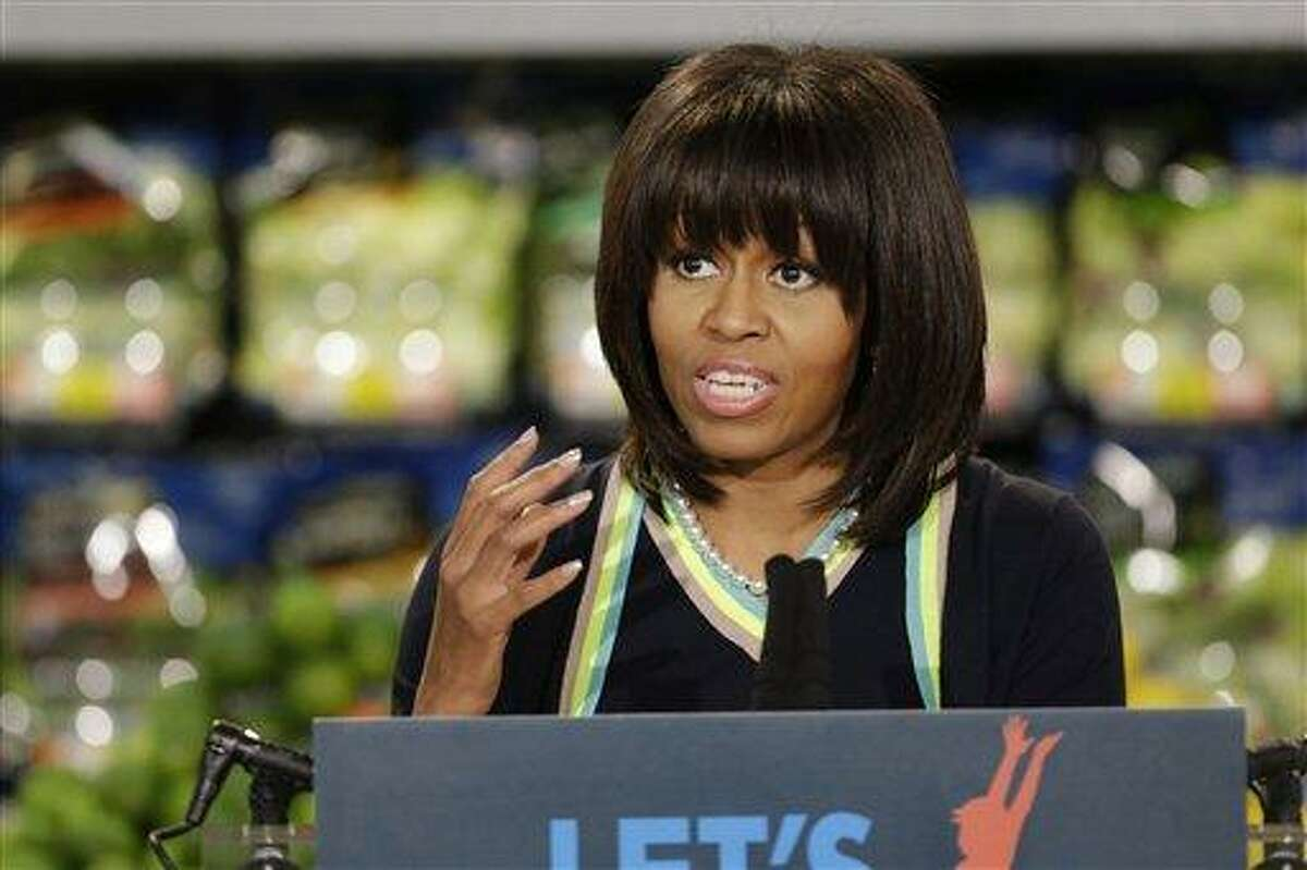 First lady Michelle Obama speaks to a small crowd at a Walmart Neighborhood Market in Springfield, Mo., Thursday, Feb. 28, 2013. (AP Photo/Orlin Wagner)