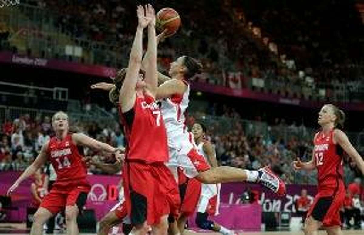 ASSOCIATED PRESS USA's Diana Taurasi drives to the basket against Canada's Courtnay Pilypaitis during a women's basketball game at the 2012 Summer Olympics Tuesday in London.