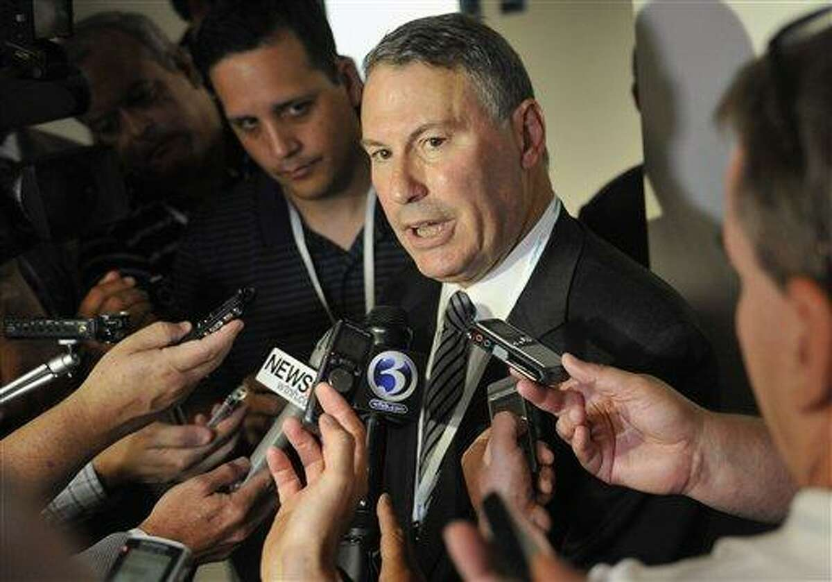 FILE - This Aug. 30, 2012 file photo shows Big East commissioner Mike Aresco answering questions from the media before an NCAA college football game between Connecticut and Massachusetts at Rentschler Field in East Hartford, Conn. Aresco is working with the officials from the conference's seven nonfootball members to keep the rebuilding league from splitting apart. A person familiar with the situation tells The Associated Press that Aresco and officials from those seven Catholic schools held a conference call Thursday, Dec. 13, 2012 to discuss the future of the league. (AP Photo/Jessica Hill, File)