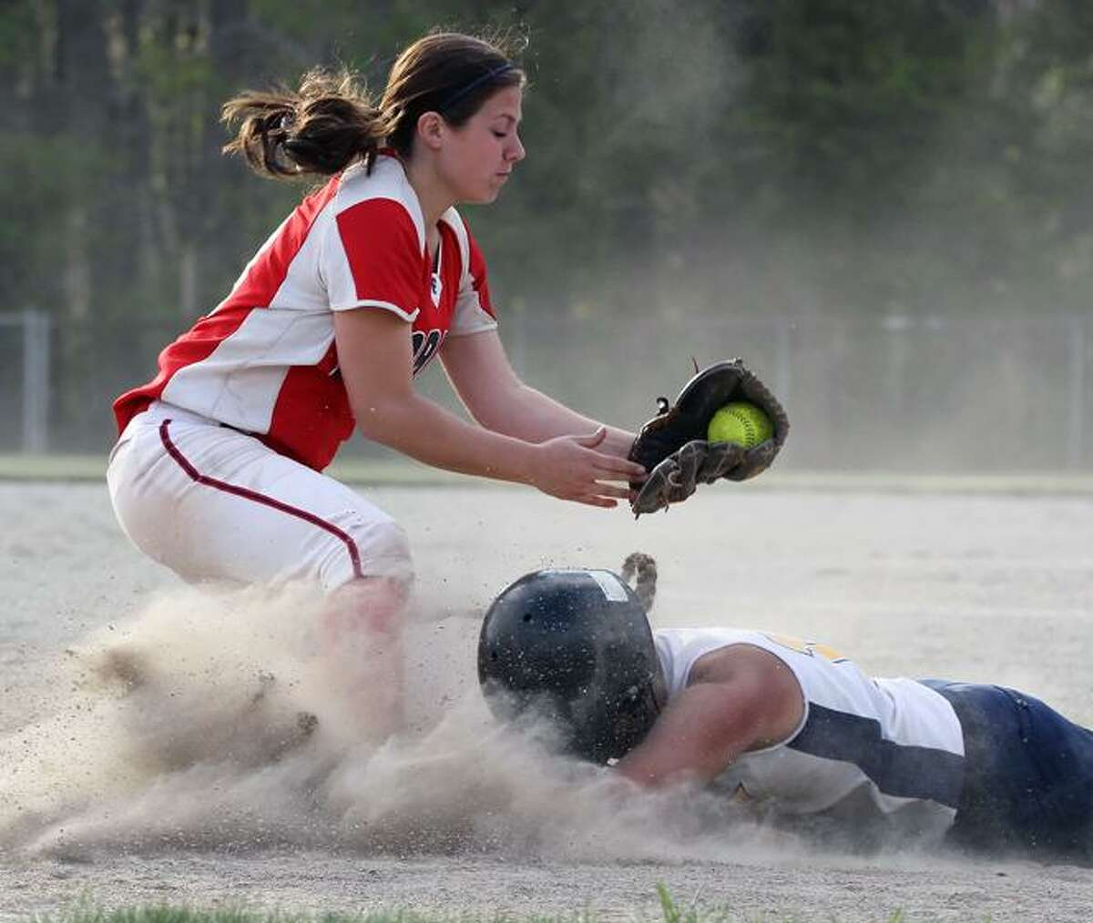 Special to the Press 04.20.12. Mercy's Brooke Franco beats the throw home and scores Mercy's final run in Friday's softball game against Foran. Foran won, 9-4. To buy a glossy print of this photo and more, visit www.middletownpress.com