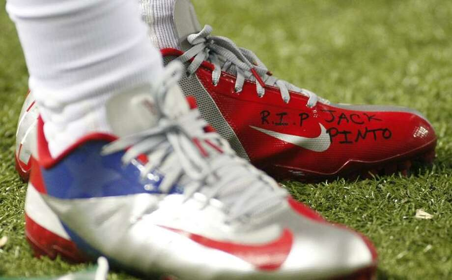 """The shoe of New York Giants wide receiver Victor Cruz bears the words """"R.I.P. Jack Pinto"""" in memory of one of the children killed in the Sandy Hook Elementary School shootings in Newtown, Connecticut, during first half NFL play against the Atlanta Falcons, in Atlanta, Georgia, December 16, 2012.   REUTERS/Tami Chappell Photo: REUTERS / X00052"""