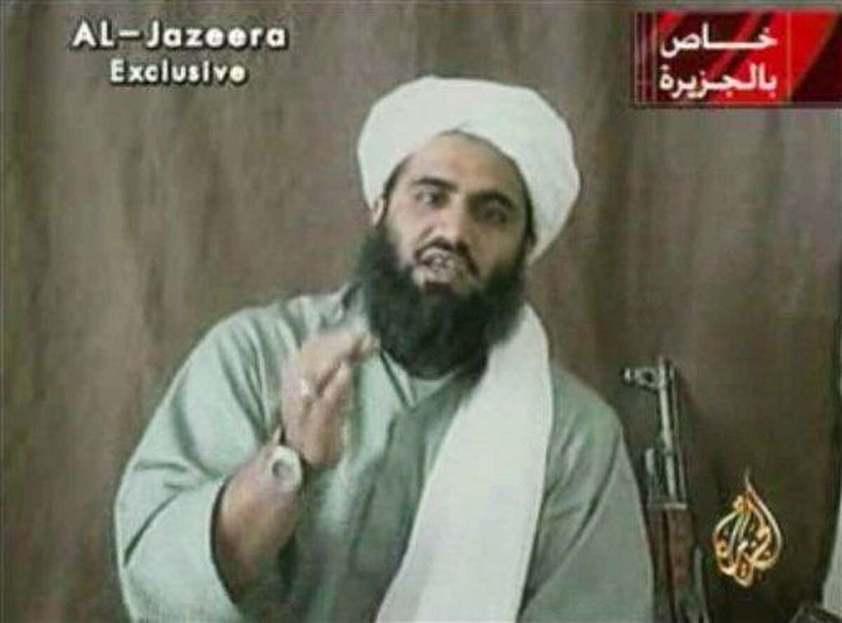 """This image made available by Al-Jazeera shows Sulaiman Abu Ghaith, Osama bin Laden's son-in-law and spokesman. Abu Ghaith has been captured by the United States, officials said Thursday, March 7, 2013, in what a senior congressman called a """"very significant victory"""" in the fight against al-Qaida. (AP Photo/Al-Jazeera)"""