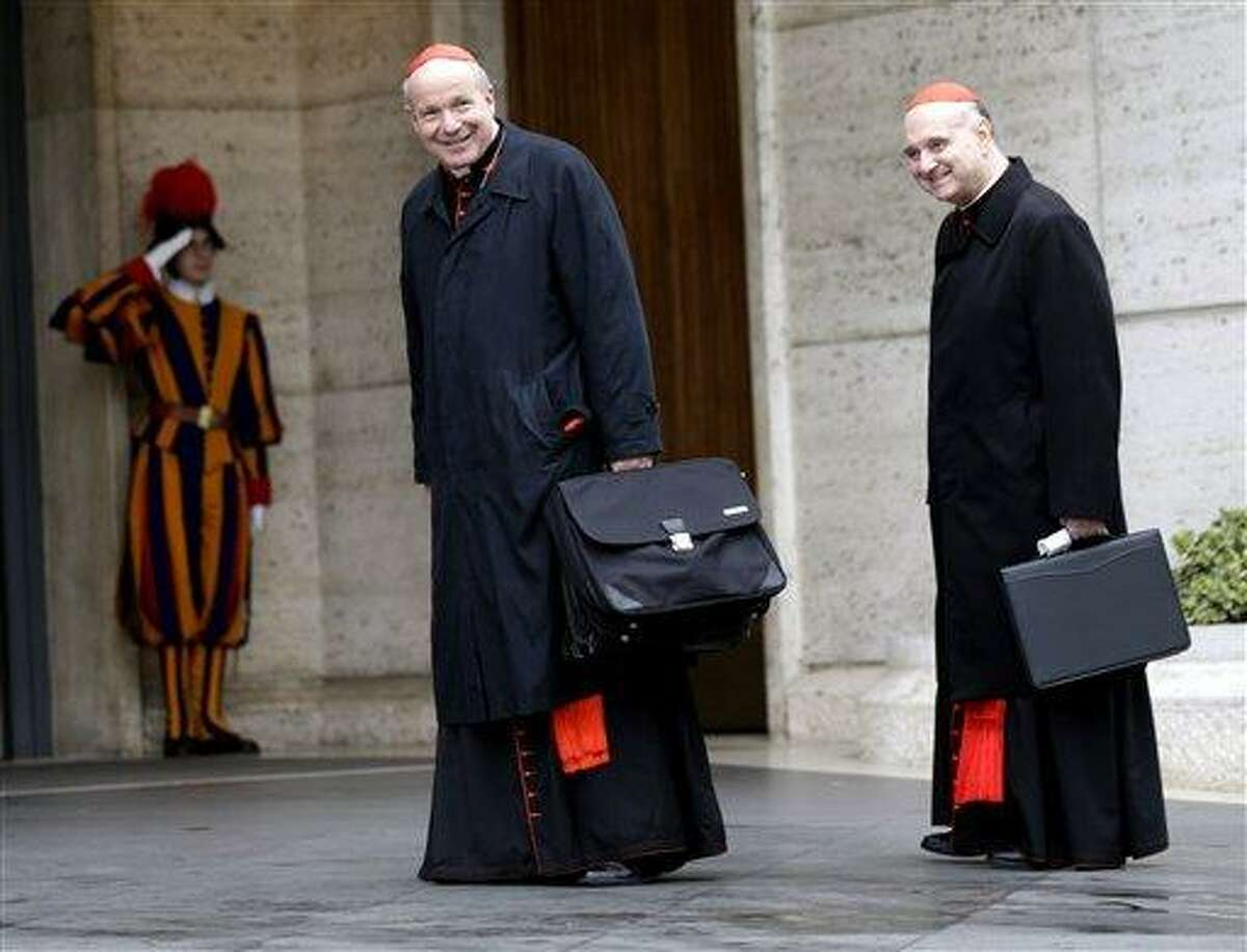 """Cardinal Christoph Schoenborn, center, and Cardinal Angelo Comastri arrive for an afternoon meeting, at the Vatican, Friday, March 8, 2013. The Vatican says the conclave to elect a new pope will likely start in the first few days of next week. The Rev. Federico Lombardi told reporters that cardinals will vote Friday afternoon on the start date of the conclave but said it was """"likely"""" they would choose Monday, Tuesday or Wednesday. The cardinals have been attending pre-conclave meetings to discuss the problems of the church and decide who among them is best suited to fix them as pope. (AP Photo/Alessandra Tarantino)"""