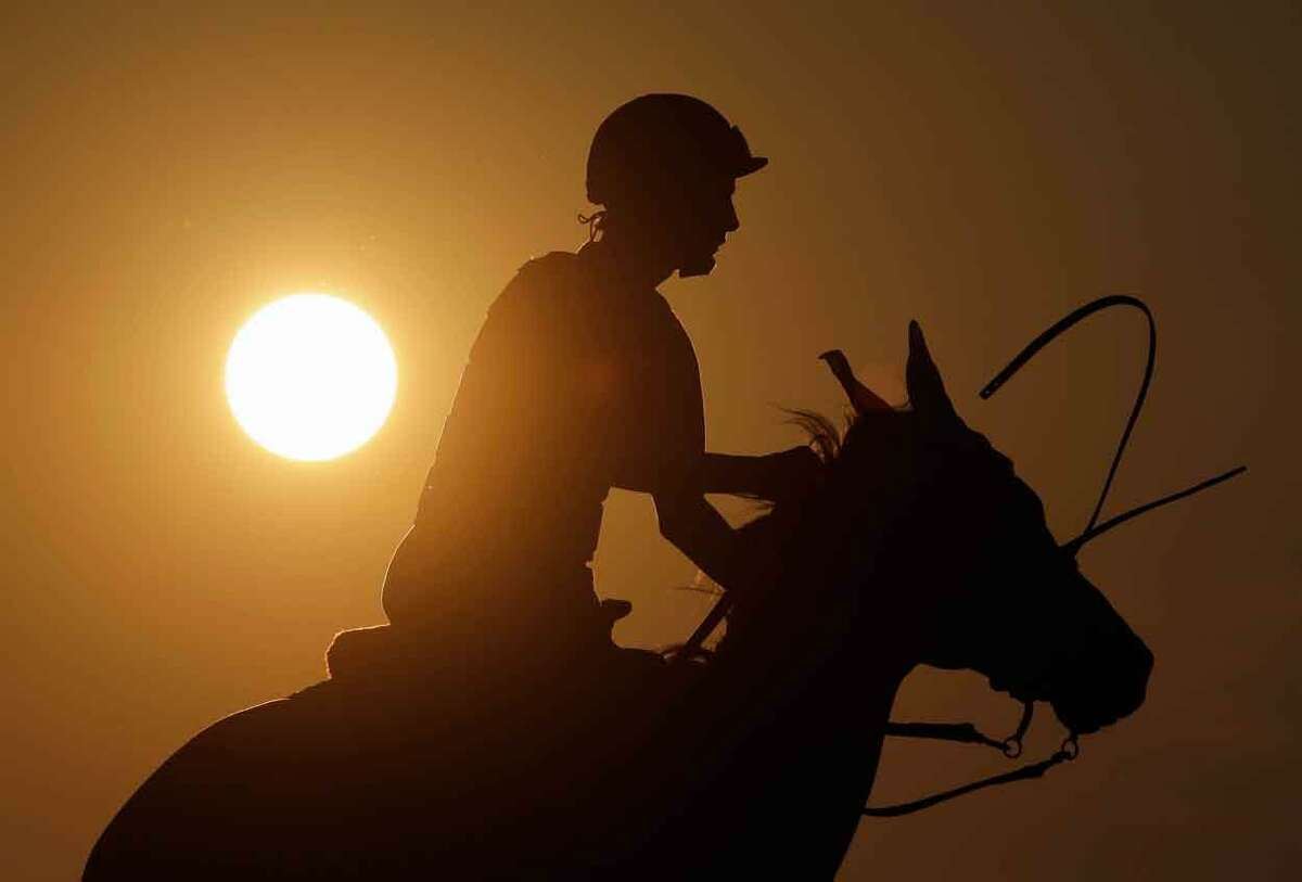 Saratoga Race Course pony boy Jesse Costa rides Vegas early Thursday morning, July 18, 2013, in Saratoga Springs, N.Y. The 150th horse racing meet at Saratoga opens on Friday. (AP Photo/Mike Groll)