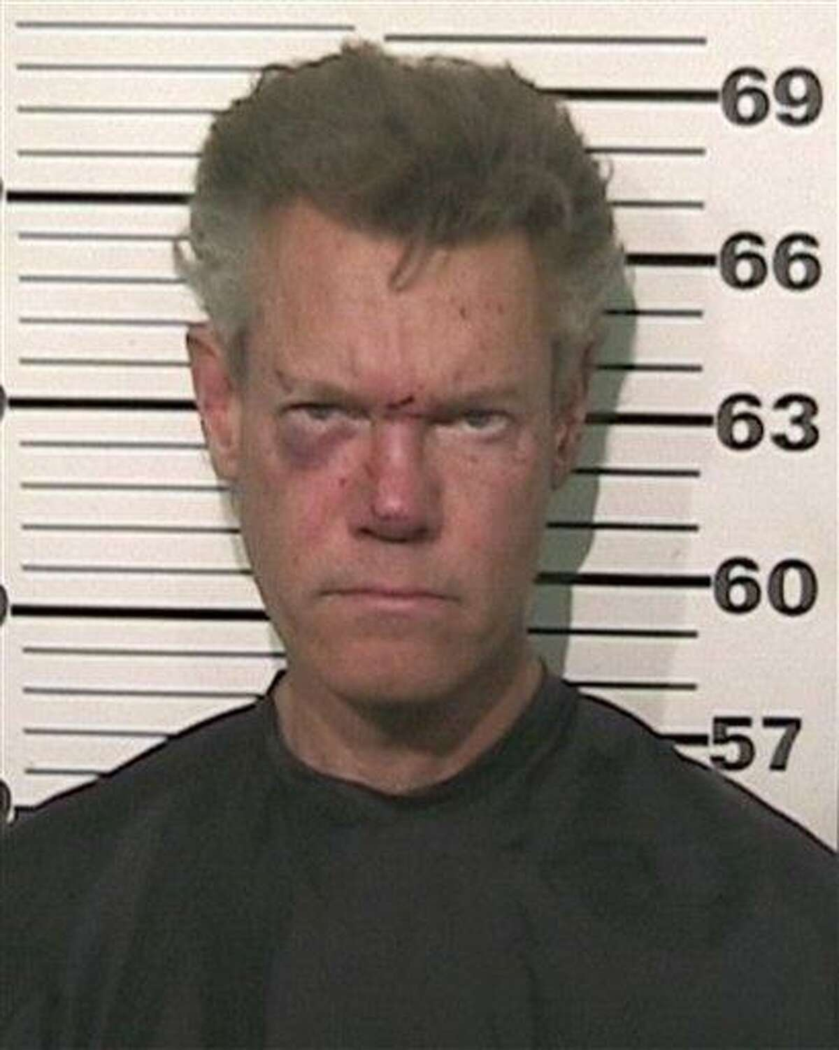 This photo provided by the Grayson County, Texas, Sheriff's Office shows Country singer Randy Travis who has been charged with driving while intoxicated. Associated Press