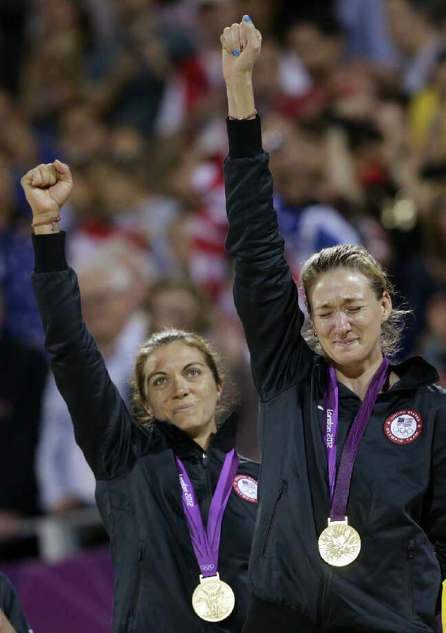 ASSOCIATED PRESS The United State's Missy May-Treanor, left, and Kerri Walsh Jennings celebrate during the medal ceremony following a win over April Ross and Jennifer Kessy in the women's gold medal beach volleyball match between two United States teams at the 2012 Summer Olympics Wednesday in London.