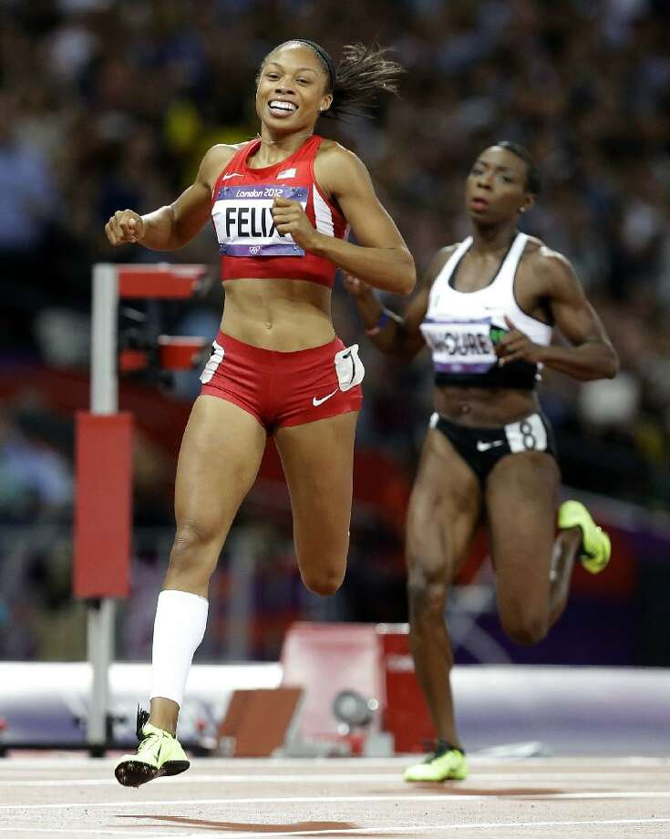 ASSOCIATED PRESS United States' Allyson Felix crosses the finish line to win the women's 200-meter final ahead of Ivory Coast's Murielle Ahoure during the athletics in the Olympic Stadium at the 2012 Summer Olympics London on Wednesday.