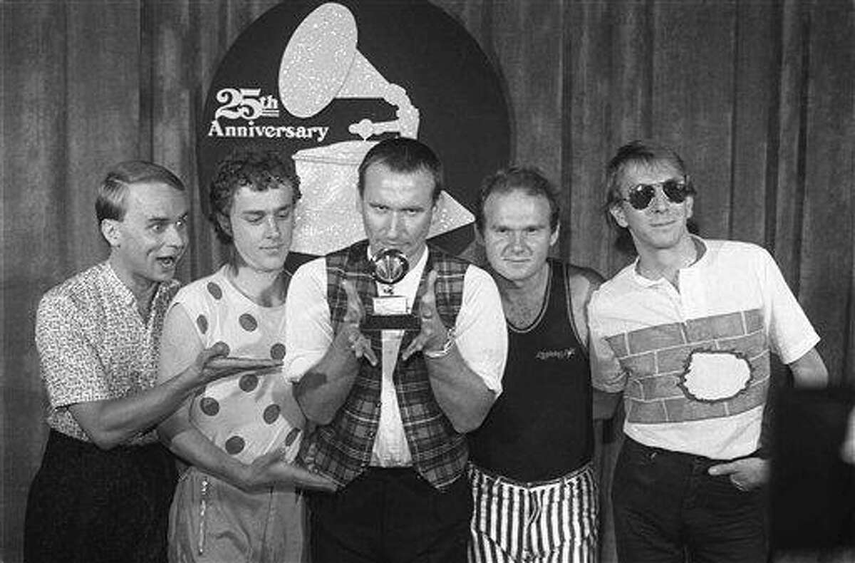 """Members of """"Men at Work,"""" in 1983 from left, Greg Ham, Ron Strykert, Colin Hay, Jerry Speiser and John Rees, pose with their Grammy for best new artist at the awards show in Los Angeles. Ham, a musician with the iconic Australian band Men at Work, was found dead in his Melbourne home Thursday Australian reports said. Associated Press"""