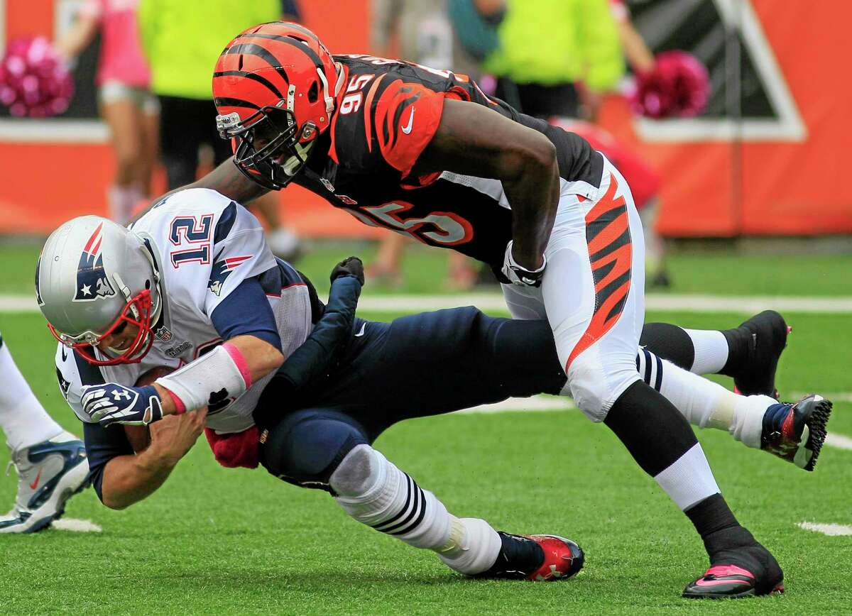 Patriots quarterback Tom Brady is sacked by Bengals defensive end Wallace Gilberry in the first half Sunday.