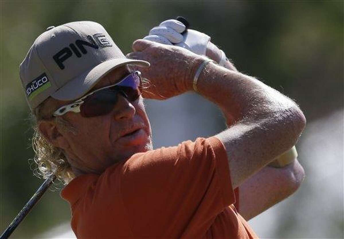 Miguel Angel Jimenez of Spain plays a shot off the 10th tee during the second round of the British Open Golf Championship at Muirfield, Scotland, Friday July 19, 2013. (AP Photo/Jon Super)