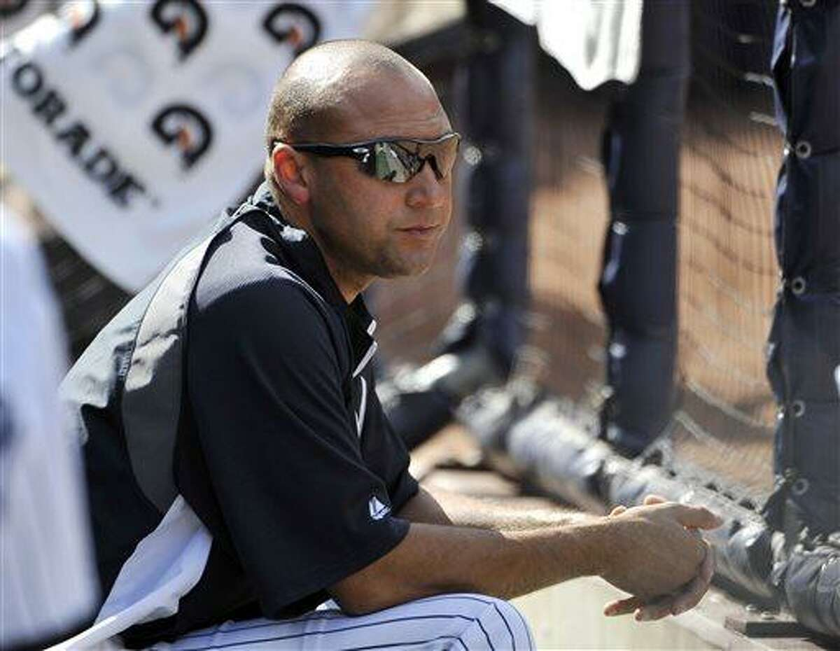 New York Yankees' Derek Jeter watching the game against the Minnesota Twins from the dugout in the eighth inning at Yankee Stadium on Sunday, July 14, 2013 in New York. Jeter is out with a strained quadricep. (AP Photo/Kathy Kmonicek)