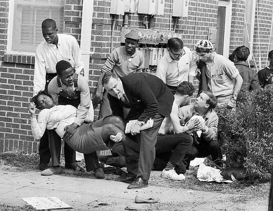 Mrs. S.W. Boynton is aided by two men after she was injured when state police broke up a demonstration march in Selma, Alabama, March 7, 1965. Mrs. Boynton, wife of a real estate and insurance man, has been a leader in civil rights efforts. (AP Photo) Photo: AP / 1965 AP