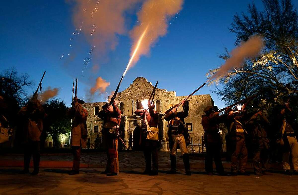 Members of the San Antonio Living History Association fire muskets as they take part in a pre-dawn memorial ceremony to remember the 1836 Battle of the Alamo and those who fell on both sides, Wednesday, March 6, 2013, in San Antonio. (AP Photo/Eric Gay)