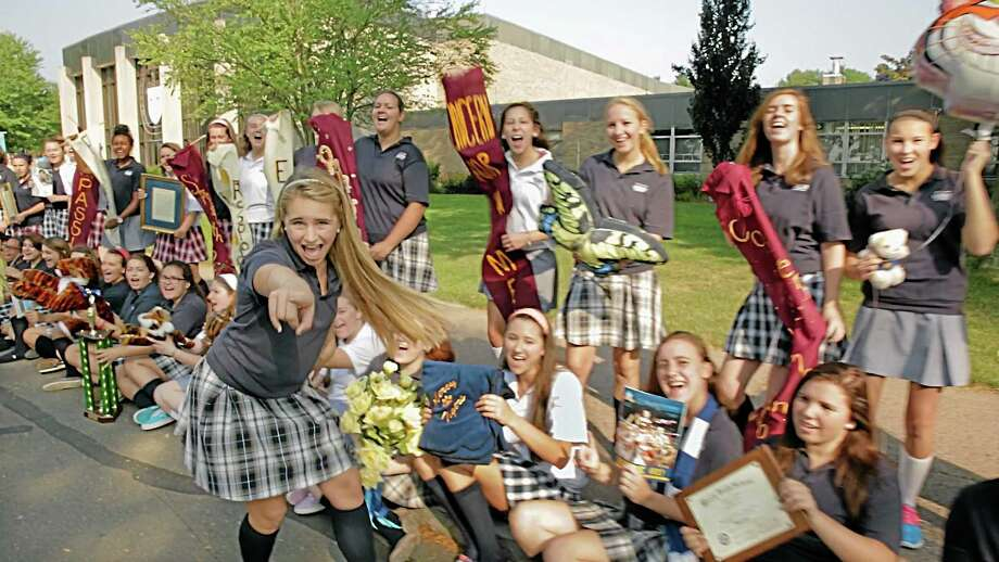 "A still shot featuring Mercy High School junior Ellie Frechette (foreground) from the ""Mercy Tigers ROAR!"" video, shot by Mercy parent and freelance broadcaster Clem Kasinskas in September. ""The original intention for the video was for our accreditation in October, open house on Nov. 3, and our 50th anniversary events that start in March 2014,"" said Mercy's communications director Marie Kalita-Leary. Photo: Journal Register Co."