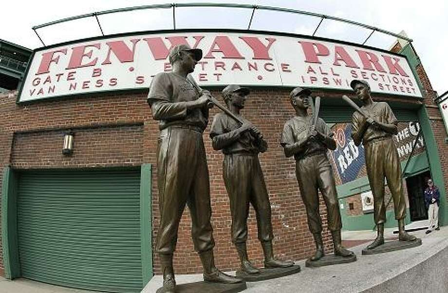"The ""Teammates"" statue is seen at the entrance to Gate B at Fenway Park in Boston Monday, April 9, 2012. The Boston Red Sox baseball home opener is Friday, April 13, 2012. (AP Photo/Elise Amendola) Photo: ASSOCIATED PRESS / AP2012"