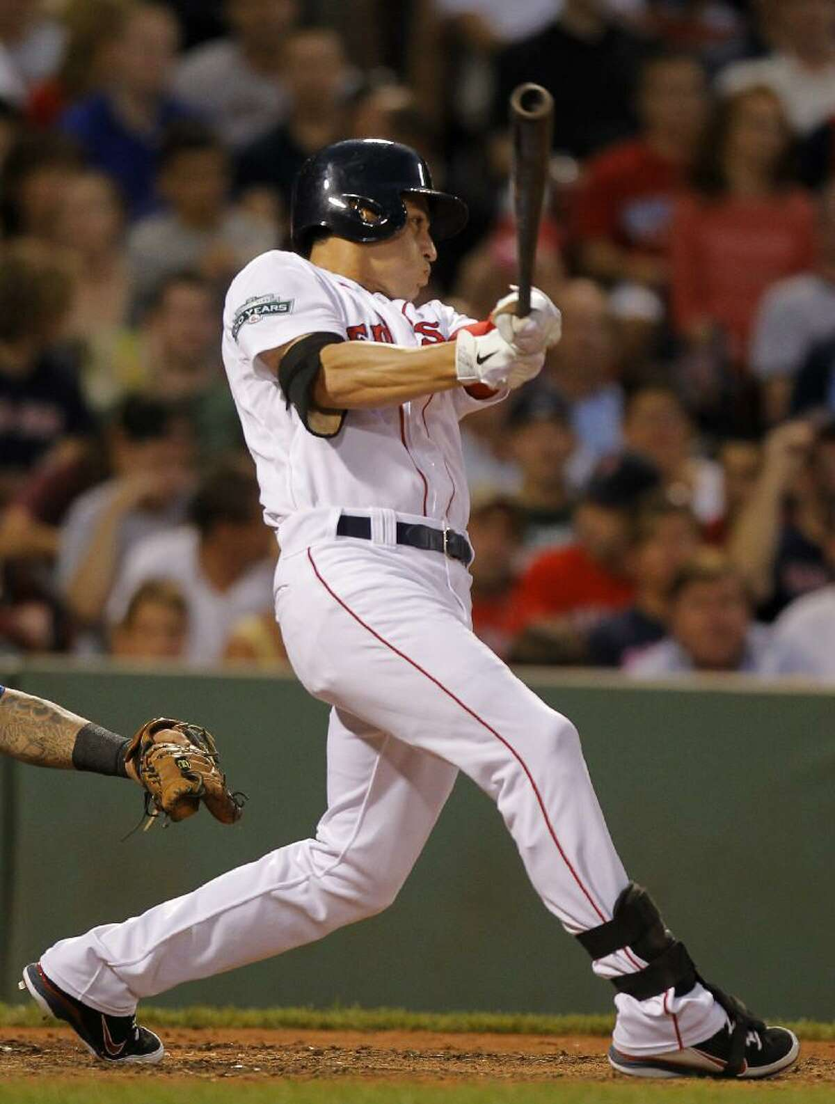 ASSOCIATED PRESS Boston Red Sox's Jacoby Ellsbury doubles on a pitch by Texas Rangers' Yu Darvish in the third inning of Monday's game at Fenway Park in Boston. The Red Sox won 9-2.