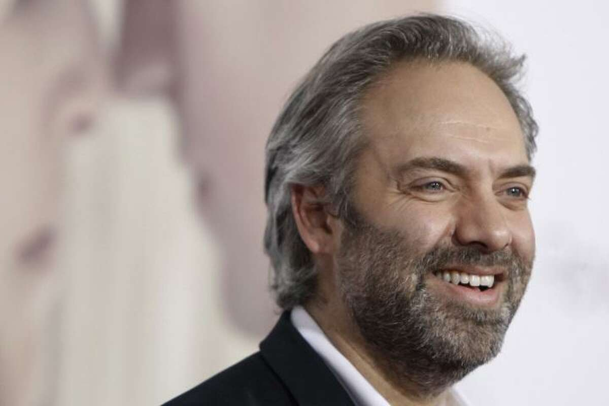 """Sam Mendes arrives at the premiere of """"Revolutionary Road"""" in Los Angeles on Monday, Dec. 15, 2008. (AP Photo/Matt Sayles)"""