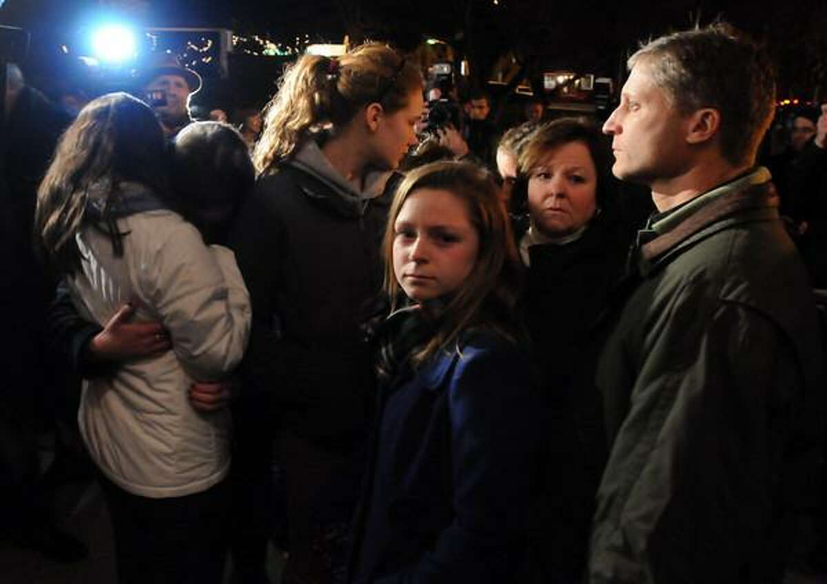 Mourners gather at a vigil for the Newtown victims.