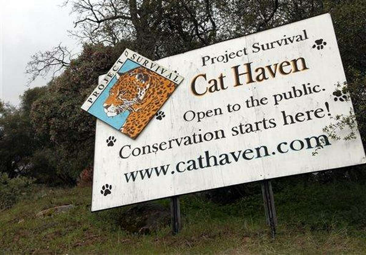 This Wednesday, March 6, 2013 photo shows a sign posted near the gate near at the entrance of Cat Haven, the exotic animal park in central California where a 26-year old female volunteer intern was killed by a lion, in Dunlap, Calif. (AP Photo/Gosia Wozniacka)