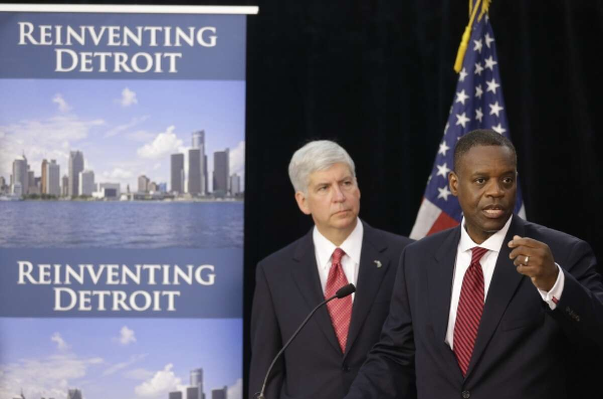 In a July 19, 2013, file photo state-appointed emergency manager Kevyn Orr, right, and Michigan Gov. Rick Snyder, address the media during a news conference in Detroit.
