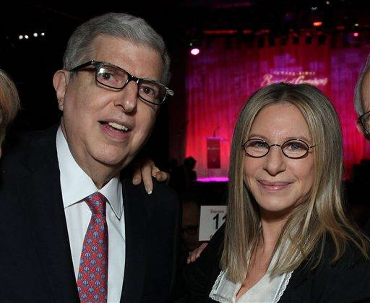 """In this2011 file photograph, originally released by Cedars-Sinai Medical Center, composer Marvin Hamlisch, left, and Barbra Streisand attend the Cedars-Sinai Board of Governors Gala at The Beverly Hilton Hotel in Beverly Hills, Calif. Hamlisch, a conductor and award-winning composer best known for the torch song """"The Way We Were,"""" died Monday, Aug. 6, 2012 in Los Angeles. He was 68. (AP Photo/Cedars-Sinai Medical Center, Alex J. Berliner, file )"""