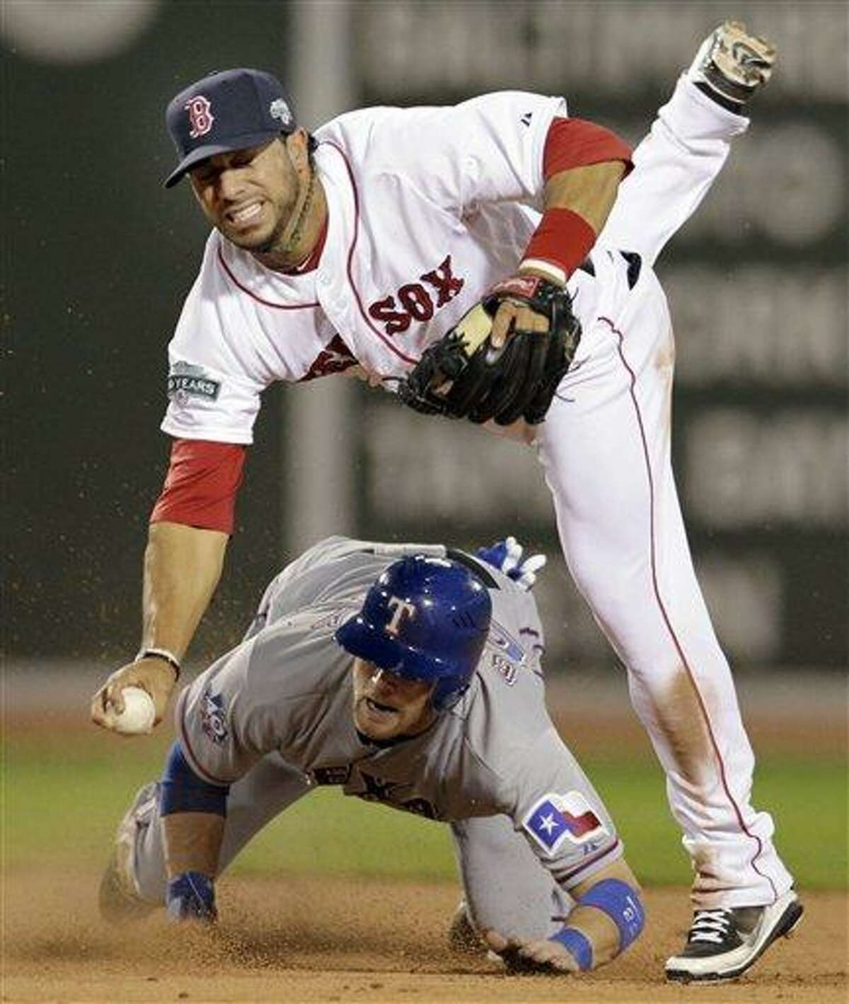 Texas Rangers' Craig Gentry slides into second to break up a double play as Boston Red Sox shortstop Mike Aviles cannot make a play to first during the fifth inning of a baseball game at Fenway Park in Boston, Tuesday, April 17, 2012. Ian Kinsler was safe at first. (AP Photo/Elise Amendola)