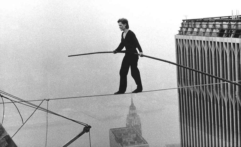 Philippe Petit, a French high wire artist, walks across a tightrope suspended between the World Trade Center's Twin Towers. New York, Aug. 7, 1974. (AP Photo/Alan Welner) Photo: ASSOCIATED PRESS / AP1974