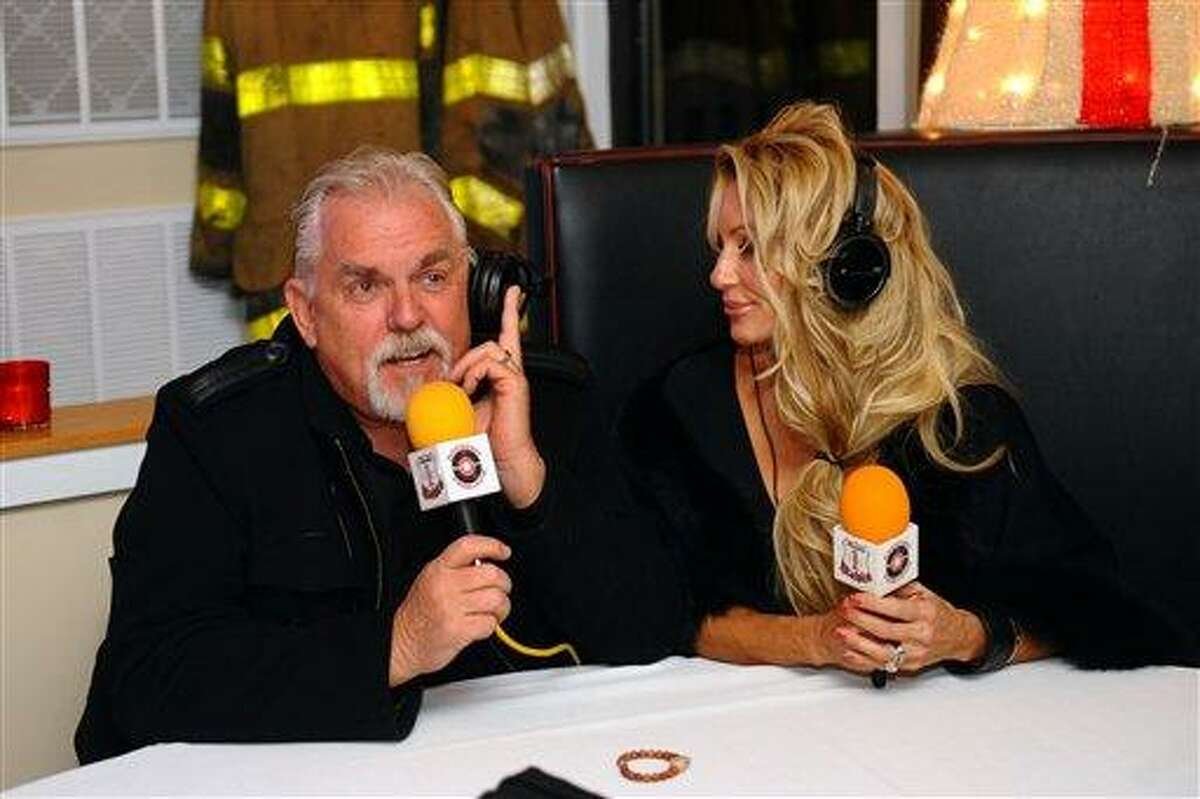FOR USE IN WEEKEND EDITIONS DEC. 15-16 - In this Dec. 6, 2012 photo, actor John Ratzenberger, a Bridgeport native, and his wife Julie take part in a live radio broadcast in Bridgeport, Conn. (AP Photo/Connecticut Post, Christian Abraham) MANDATORY CREDITY